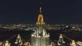 Moscow State University Main Campus and Illuminated Moscow Cityscape at Night. Russia. Aerial View. Moscow State University Main Campus and Illuminated Moscow stock video