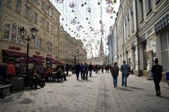 Moscow street near Red square. April. Lights and butterflies Stock Photos