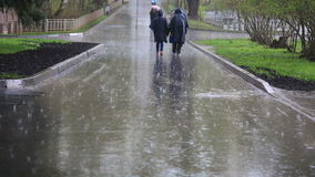 Moscow street with pedestrians walking under the rain stock video footage