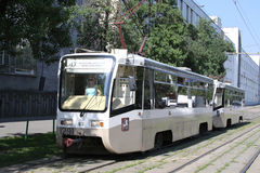 Moscow at summer. Tramway on the moscower street. Moscow at summer. Tramway is going vis the small moscower street Stock Photos
