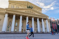 Two young people walk on the square in front of the Bolshoi theater royalty free stock photos