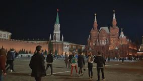 Moscow. Tourists and passersby are walking along Red Square in Moscow. Evening city. Spring. stock video footage