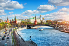 Moscow transport. View of the Moscow Kremlin by a sunny cloudy day and Moscow transport: cars and a ship Royalty Free Stock Images
