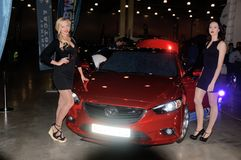 Moscow Tuning Show 2015. Beauties models work at the exhibition Royalty Free Stock Photography