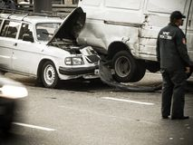 Car accidents. Russia, 2010: Rescuer stand on the road about two old crashed russian automobiles GAZ stock photography