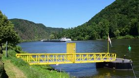 Mosel River, Germany. Cargo ship moving down river. stock footage