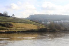 Mosel River in the winter time. A Mosel River, in the winter time. Photo made from the Route du vin,  in Luxembourg. High level of water due to many rains Royalty Free Stock Photo
