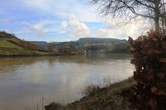 Mosel River in the winter time. A Mosel River, in the winter time. Photo made from the Route du vin,  in Luxembourg. High level of water due to many rains Royalty Free Stock Images