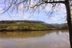 Mosel River in the winter time. A Mosel River, in the winter time. Photo made from the Route du vin,  in Luxembourg. High level of water due to many rains Royalty Free Stock Photography