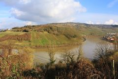 Mosel River in the winter time. A Mosel River, in the winter time. Photo made from the Route du vin,  in Luxembourg. High level of water due to many rains Royalty Free Stock Photos