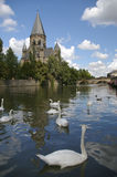 Moselle river and church metz france. Moselle river and swan on the water surface and church and bridge in background in the town of metz france Stock Image
