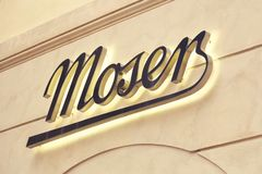 Moser在墙壁2上的商店标志 免版税库存照片