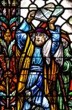 Moses. Stained glass fragment depicting Moses carrying tablets with Ten Commandments stock photos