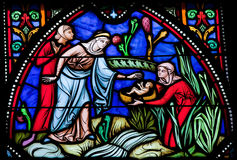 Moses Found in the Nile. Stained glass window in the cathedral of Brussels stock image
