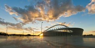 Moses Mabhida Stadium en la salida del sol Foto de archivo libre de regalías