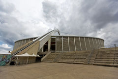 Moses Mabhida Stadium Stairs And Arch. The arch that carries the Skycar to the top of the stadium, with a flight of stairs set to the right stock photos