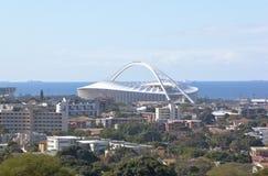 Moses Madhida Stadium Rising from Urban Landscape Stock Image