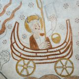 Moses sitting in an ark with two weels holding the Stone Tablets. Moses with two horns, sitting in the Ark of the Covenant, with two weels, a medieval mural in stock images