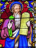 Moses on stained glass window. A stained glass window showing Moses and the Ten Commandments in the church in Nantwich in Cheshire, England Royalty Free Stock Photos