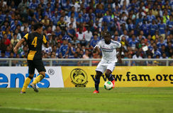 Moses victor. SHAH ALAM - JULY 21: Chelsea Football Club player Victor Moses (white jersey) controls the ball in a friendly match with the Malaysian national Royalty Free Stock Image