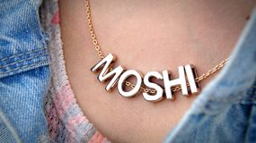 Moshi necklace with jeans jacket and clean neck. Inn young woman Stock Photography