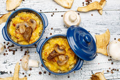Moshroom casserole in a blue ceramic pot Royalty Free Stock Images