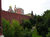 Moskau kremlin. Kremlin in moskau, russia on white blue sky behind border of red wall Stock Photo
