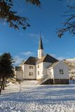 Moskenes Church during winter. Lofoten, Norway. Church in Moskenes at winter time with snow and trees royalty free stock photos