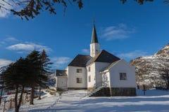 Moskenes Church in winter season. Lofoten, Norway. Church in Moskenes at winter time with snow and trees. Lofoten, Norway Stock Photo