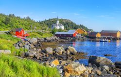 Moskenes fishing village in Lofoten Islands and Moskenes Church. Parish church in the municipality of Moskenes north of Sorvagen in Nordland county. Norway Royalty Free Stock Photography