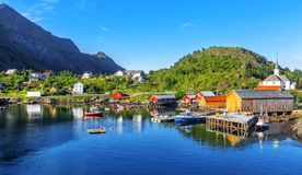 Moskenes fishing village in Lofoten Islands and Moskenes Church. Parish church in the municipality of Moskenes north of Sorvagen in Nordland county. Norway Stock Images