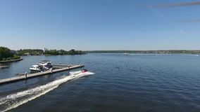 Moskow, Russia - MAY 15, 2018 amphibious vehicle , WaterCar Panther , Red Car , swimming on the river by car.  stock footage