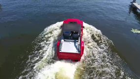 Moskow, Russia - MAY 15, 2018 amphibious vehicle , WaterCar Panther , Red Car , swimming on the river by car.  stock video