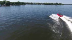 Moskow, Russia - MAY 15, 2018 amphibious vehicle , WaterCar Panther , Red Car , swimming on the river by car.  stock video footage
