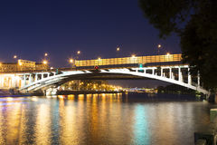 Moskva River, Andreyevsky Bridge in the light of night colored lights. Moscow, Russia Stock Photos