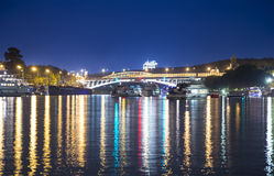 Moskva River, Andreyevsky Bridge in the light of night colored lights. Moscow, Russia Royalty Free Stock Photo