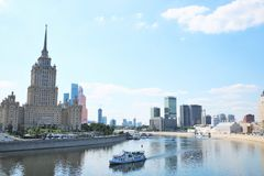 Moskva River and Ukraina Hotel. Moskva River passing through the centre of Moscow, the capital of the Russian Federation. On the left side, the famous luxury Stock Image