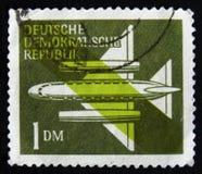 MOSKVA RYSSLAND - APRIL 2, 2017: En stolpestämpel som skrivs ut i DDR (ger Arkivfoton