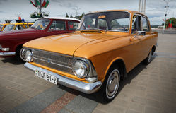Moskvitch 412. Yellow Moskvitch 412 Volga  at exibition of vintage cars. Summer. Belarus. Vitebsk. 2017 Royalty Free Stock Photo