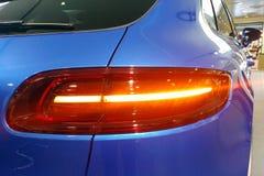 Moskwa Rosja, Kwiecień, - 22, 2019: Zamyka w górę i taillights premii Porsche Macan GTS błękitny skrzyżowanie w handlowa centrum fotografia royalty free