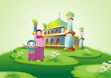 Moslem Mom and kid with mosque Royalty Free Stock Photo