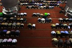 Moslem Religious prayer. All Moslemm make religious bow in the weekly pray in Friday, inside of the biggest Mosque in South East Asia, Istiqlal, located in Royalty Free Stock Image