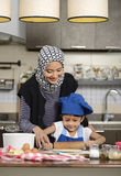 Moslem Woman Teaching Her Daughter Stock Photography