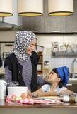 Moslem Woman Teaching Her Daughter Stock Photo