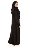 Moslemische Frau, die zurück schaut Lizenzfreies Stockfoto
