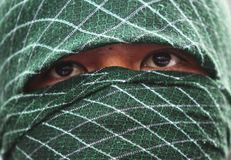 Moslemische Männer, die Maske tragen Stockfotografie