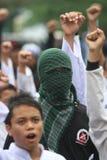 Moslemische Männer, die Maske tragen Lizenzfreie Stockfotografie