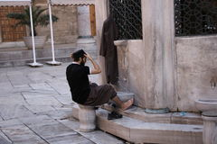 Moslemische Mannwaschung Stockbilder