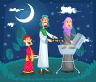 Moslimfamilie die van barbecue genieten Stock Afbeelding