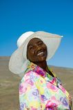 Mosotho Lady at work 2. An agricultural worker straightens up after hours of hoeing and still room for a smile Royalty Free Stock Photo
